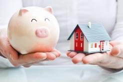 bigstock-Hands-Holding-A-Piggy-Bank-An-AG-article